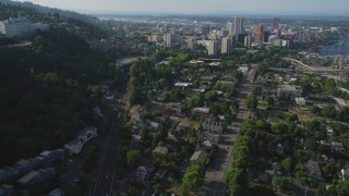 AX53_064 - 5K stock footage aerial video of tracking a gondola over homes and city streets, Southwest Portland, Oregon
