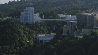 AX53_066 - 5K stock footage aerial video of tracking a gondola revealing Oregon Health and Science University, Portland, Oregon