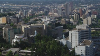 AX53_070 - 5K stock footage aerial video fly by Oregon Health and Science University revealing Downtown Portland, Oregon