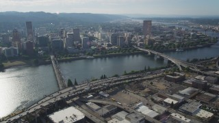 AX53_074 - 5K stock footage aerial video of Downtown Portland city buildings seen from across the Willamette River, Oregon
