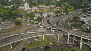 AX53_081 - 5K stock footage aerial video of Interstate 5 and 405 interchange pan to Medical Center, North Portland, Oregon