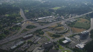 AX53_093 - 5K stock footage aerial video fly by freeway interchange with traffic backing up beside strip mall, Southwest Portland, Oregon