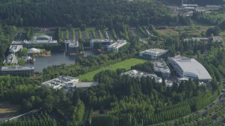 AX53_098 - 5K stock footage aerial video fly by Nike Headquarters nestled among trees, Beaverton, Oregon