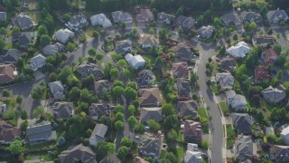 AX53_099 - 5K stock footage aerial video tilt down to bird's eye of a residential neighborhood, Beaverton, Oregon