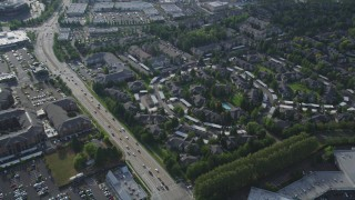 AX53_101 - 5K stock footage aerial video pan and tilt to a bird's eye of apartment building complex, Hillsboro, Oregon