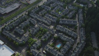 AX53_102 - 5K stock footage aerial video approach and tilt to bird's eye of apartment buildings, Hillsboro, Oregon