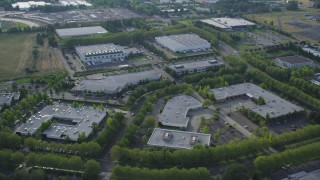 AX53_103 - 5K stock footage aerial video of flying over one-story office buildings and warehouses, Hillsboro, Oregon