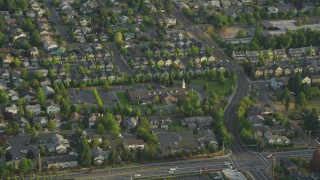 AX54_002 - 5K stock footage aerial video of passing the Church of Jesus Christ of Latter Day Saints, Beaverton, Oregon, sunset