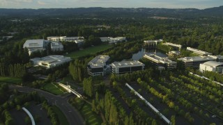 AX54_005 - 5K stock footage aerial video of flying by Nike Headquarters in Beaverton, Oregon, sunset