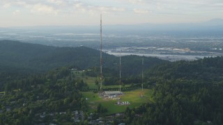 AX54_015 - 5K stock footage aerial video of flying by hilltop radio towers in Southwest Portland, Oregon, sunset