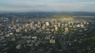 AX54_019 - 5K stock footage aerial video of flying by downtown buildings beside the Willamette River, Downtown Portland, Oregon, sunset