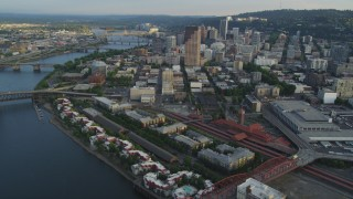 AX54_029 - 5K stock footage aerial video of approaching Downtown Portland, flying by Union Station, Portland, Oregon, sunset