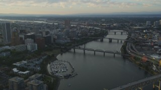 AX54_032 - 5K stock footage aerial video pass by Marquam Bridge, tilt to reveal Downtown Portland, Oregon, sunset