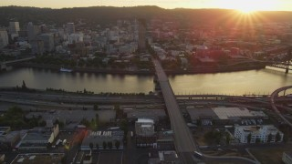 AX54_070 - 5K stock footage aerial video of approaching Burnside Bridge and US Bancorp Tower, Downtown Portland, Oregon, sunset