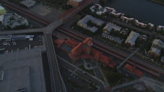 AX54_072 - 5K stock footage aerial video of bird's eye view of Union Station in Downtown Portland, Oregon, sunset