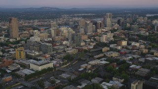 AX54_086 - 5K stock footage aerial video of approaching Downtown Portland skyscrapers, Oregon, sunset
