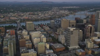 AX54_087 - 5K stock footage aerial video fly over downtown, pan to KOIN Center and Wells Fargo Center, Downtown Portland, Oregon, sunset