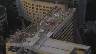 AX54_091 - 5K stock footage aerial video of orbiting helicopter on the roof of Oregon Health and Science University, Portland, Oregon, twilight