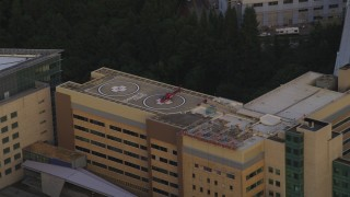 AX54_092 - 5K stock footage aerial video of orbiting helicopter, Oregon Health and Science University, Portland, Oregon, twilight