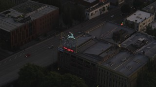 AX54_098 - 5K stock footage aerial video of tracking the White Stag Sign, Portland, Oregon, twilight