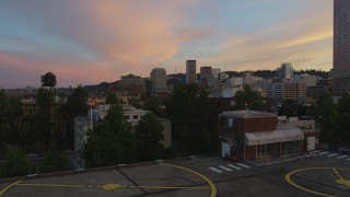AX54_107 - 5K stock footage aerial video orbit the White Stag Sign in Downtown Portland, Oregon, sunset