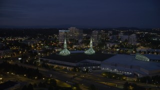 AX55_003 - 5K stock footage aerial video of approaching Oregon Convention Center and office buildings, Lloyd Center, Northeast Portland, Oregon, twilight