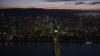 AX55_011 - 5K stock footage aerial video fly by buildings in downtown, Morrison and Hawthorne Bridges, Downtown Portland, Oregon, twilight