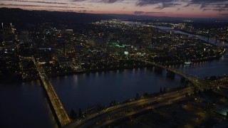 AX55_012 - 5K stock footage aerial video of flying by downtown, seen from Hawthorne Bridge, Downtown Portland, Oregon, twilight