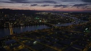 AX55_016 - 5K stock footage aerial video of downtown skyscrapers, Morrison Bridge, Burnside Street Bridge, Downtown Portland, Oregon, twilight