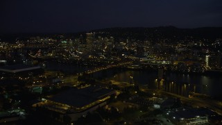 AX55_025 - 5K stock footage aerial video of approaching Broadway Bridge and Downtown Portland, Oregon, night