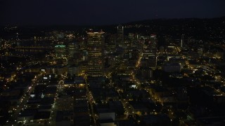 AX55_027 - 5K stock footage aerial video of approaching US Bancorp Tower and skyscrapers in Downtown Portland, Oregon, night