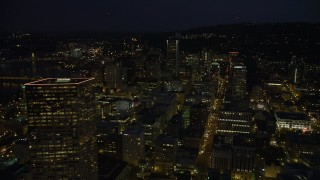 AX55_028 - 5K stock footage aerial video fly over downtown to approach KOIN Center and Wells Fargo Center, Downtown Portland, Oregon, night
