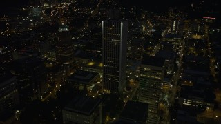 AX55_029 - 5K stock footage aerial video of flying by Wells Fargo Center, KOIN Center, Downtown Portland, Oregon, night