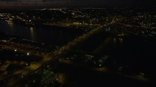 AX55_050 - 5K stock footage aerial video approach and flyby the Fremont Bridge, Downtown Portland, Oregon, night
