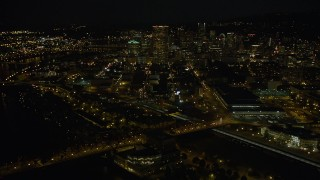 AX55_052 - 5K stock footage aerial video of approaching US Bancorp Tower from Union Station, Downtown Portland, Oregon, night
