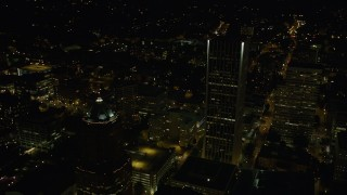 AX55_054 - 5K stock footage aerial video of flying by Wells Fargo Center, KOIN Center, Portland, Oregon, night