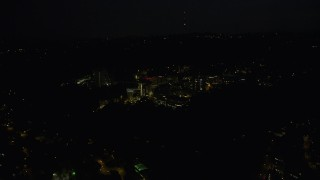 AX55_055 - 5K stock footage aerial video of flying by the Oregon Health and Science University, Portland, Oregon, night