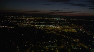 AX55_067 - 5K stock footage aerial video of approaching Tanasbourne Town Center, Hillsboro, Oregon, night