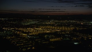 AX55_069 - 5K stock footage aerial video pan across Intel Ronler Acres and office buildings, HIllsboro, Oregon, night