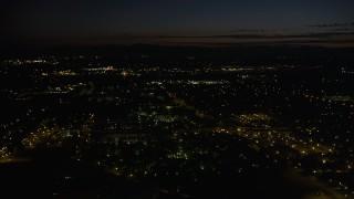 AX55_070 - 5K stock footage aerial video of flying over neighborhood in Hillsboro, Oregon, night