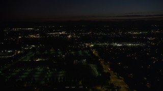 AX55_071 - 5K stock footage aerial video of flying over dark office building by neighborhood in Hillsboro, Oregon, night