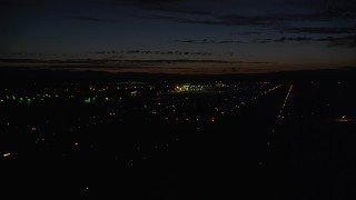 AX55_073 - 5K stock footage aerial video of flying by Hillsboro Airport, Hillsboro, Oregon, night