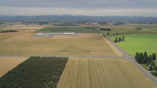 AX56_003 - 5K stock footage aerial video of farm fields, greenhouses, and country roads in Hillsboro, Oregon