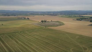 AX56_004 - 5K stock footage aerial video fly over fields to approach a small farm in Hillsboro, Oregon