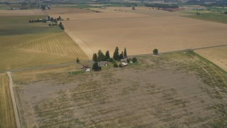 AX56_005 - 5K stock footage aerial video approach a farmhouse beside a country road in Hillsboro, Oregon