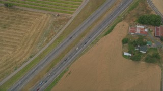 AX56_010 - 5K stock footage aerial video of bird's eye view of light traffic on Highway 26, Banks, Oregon