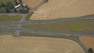 AX56_011 - 5K stock footage aerial video of bird's eye view of light traffic traveling on Highway 26, Banks, Oregon