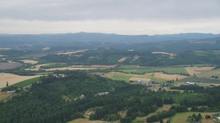 AX56_013 - 5K stock footage aerial video of passing farms and crop fields in Banks, Oregon