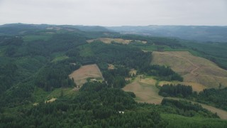 AX56_015 - 5K stock footage aerial video of hillside logging areas surrounded by evergreen forest in Banks, Oregon