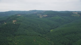AX56_017 - 5K stock footage aerial video of a view of evergreen forest and a few logging areas in Washington County, Oregon